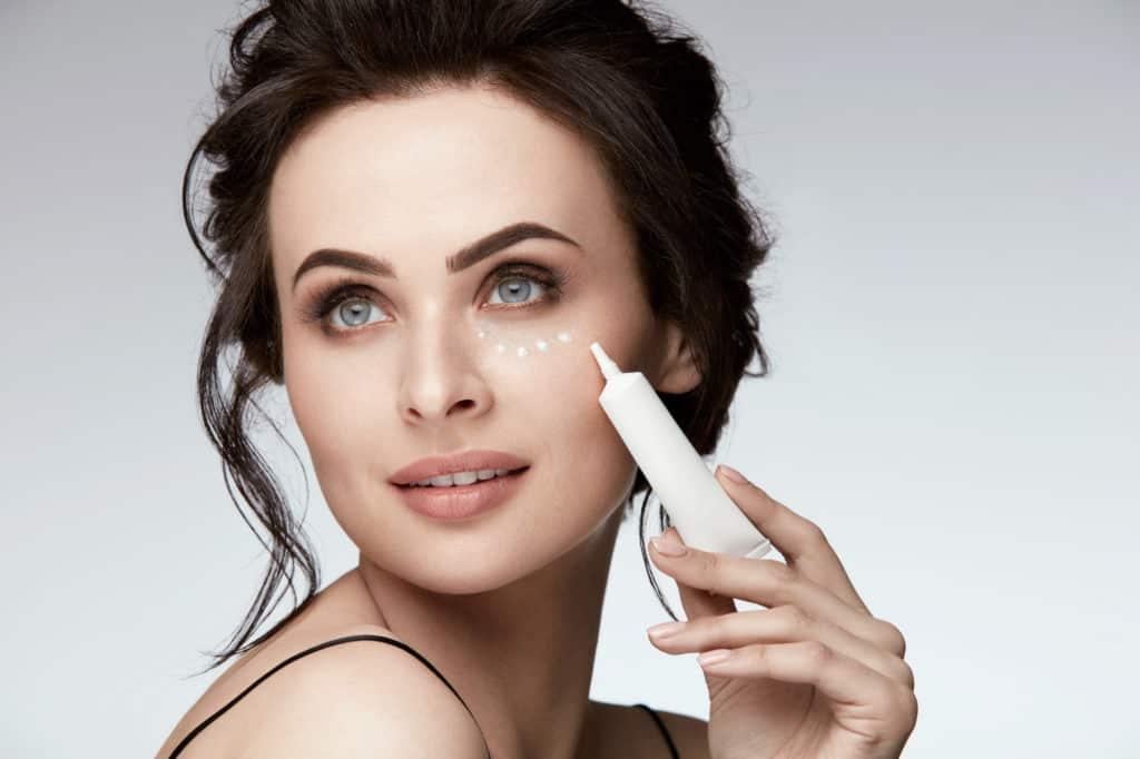 Woman Applying Eye Cream On Skin